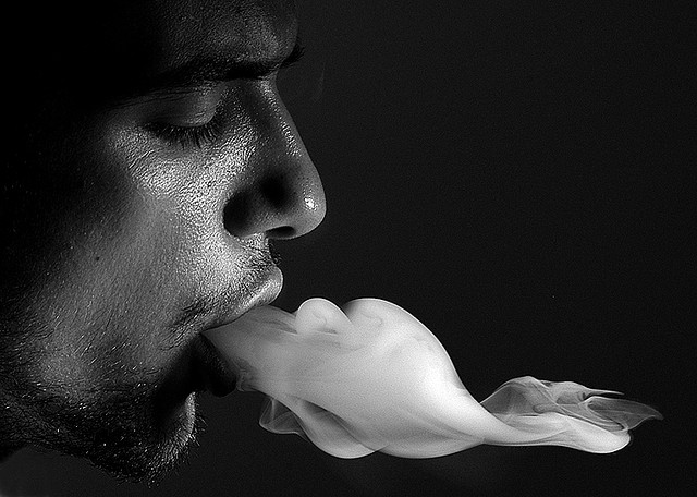 Smoke vapor from a mouth.